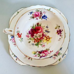 Photo of a beautiful vintage tea cup, saucer and side plate